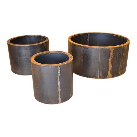 Image of   Cylinder formet plantekummer i corten